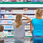 Family chooses dairy products in shop